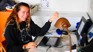 Dawn Barlow working at Fiver Finger Lighthouse, analyzing whale audio.
